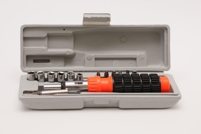 可逆螺丝刀 一套在白色背景的螺丝刀喷管 库存图片