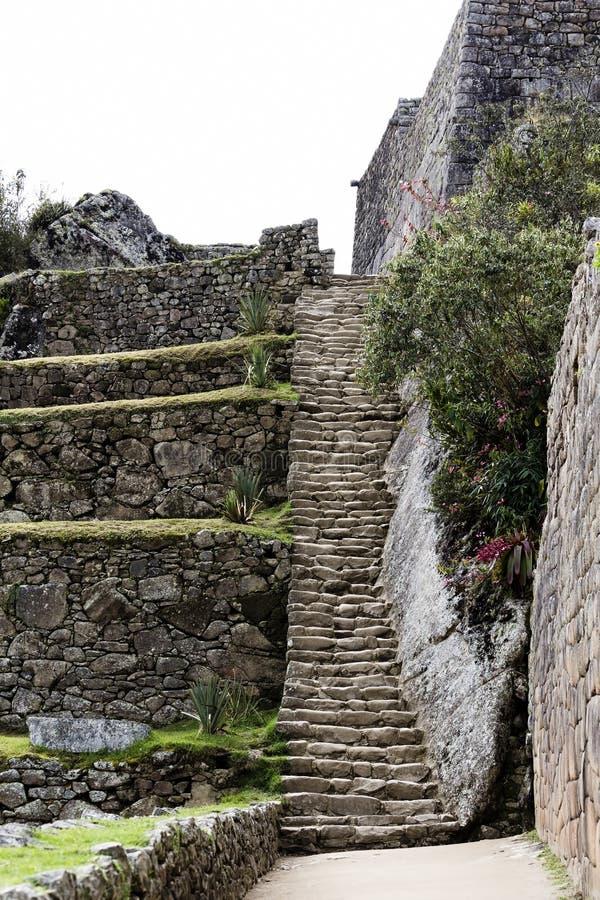 台阶和岩石墙壁马丘比丘秘鲁南美 免版税图库摄影