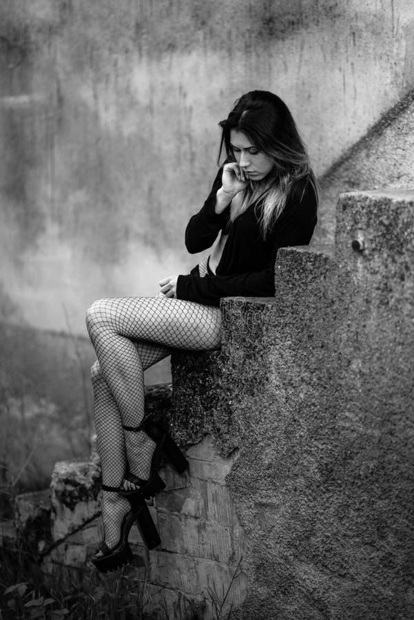 台阶的妇女 图库摄影