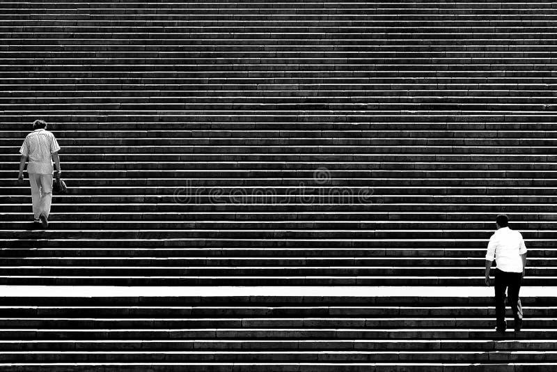 台阶的步行者 库存照片