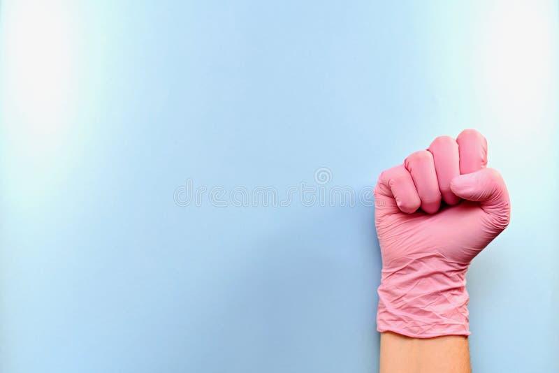 右手套的手的拳头在右边 免版税库存照片