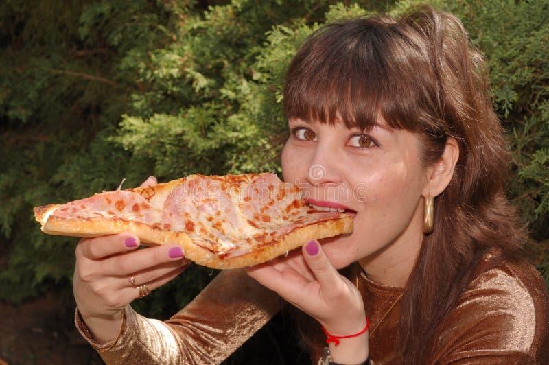 吃三明治妇女 库存图片