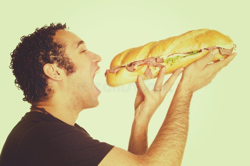 吃人三明治 免版税库存照片