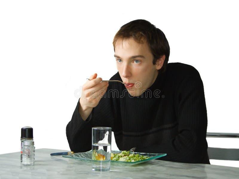 吃人年轻人 图库摄影