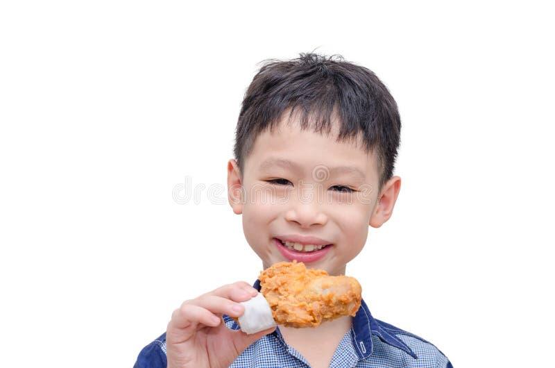 吃在白色的男孩炸鸡 图库摄影