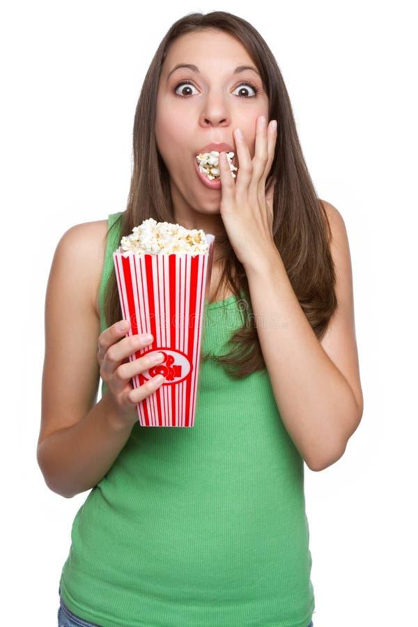 吃女孩玉米花 免版税库存照片