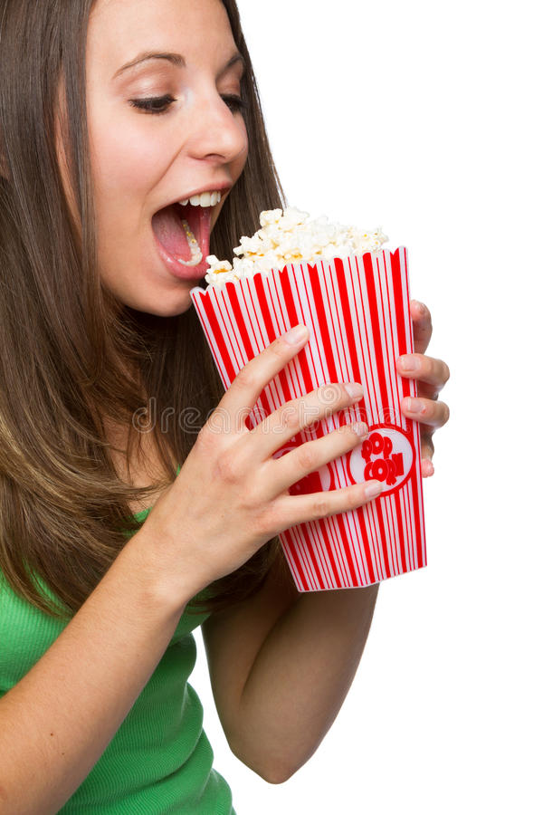 吃女孩玉米花 免版税库存图片
