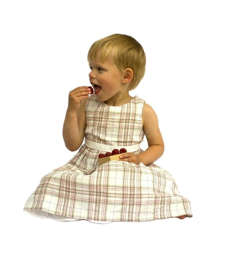 吃女孩莓 图库摄影