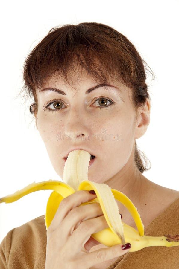 吃妇女的香蕉 免版税库存图片