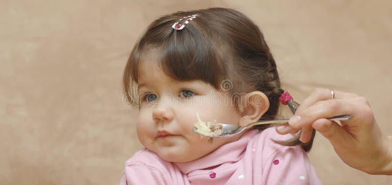 吃婴孩纵向  免版税库存照片