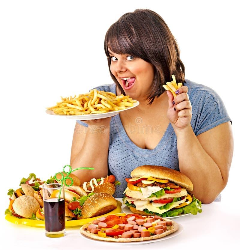 吃快餐的妇女。 库存图片
