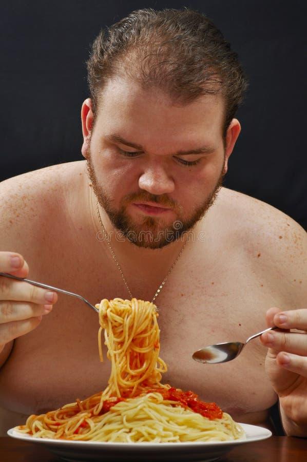 吃意大利面食 免版税库存照片