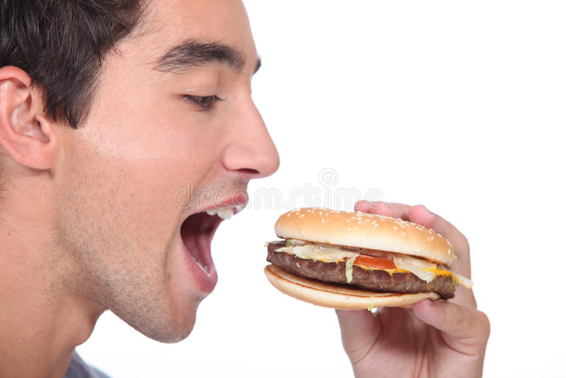 吃汉堡包人 库存照片
