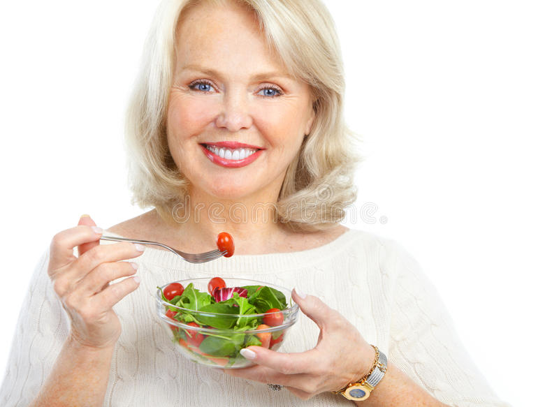吃沙拉妇女 免版税库存图片