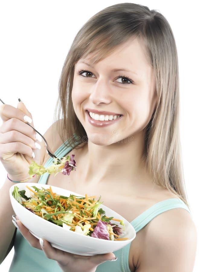 吃沙拉妇女 免版税库存照片
