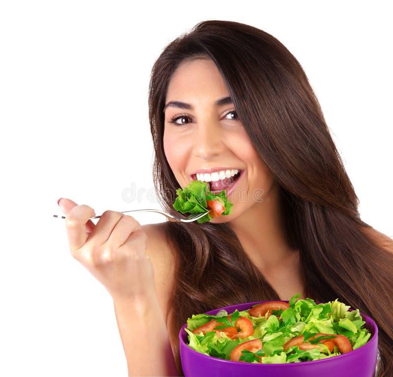 吃沙拉的美丽的妇女 库存照片
