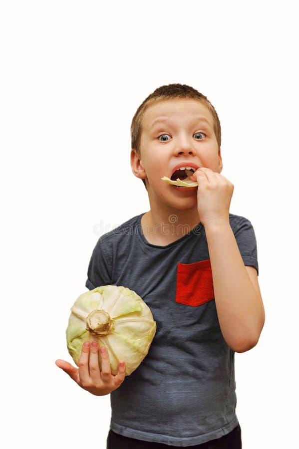 吃白椰菜的乐趣孩子 免版税库存图片