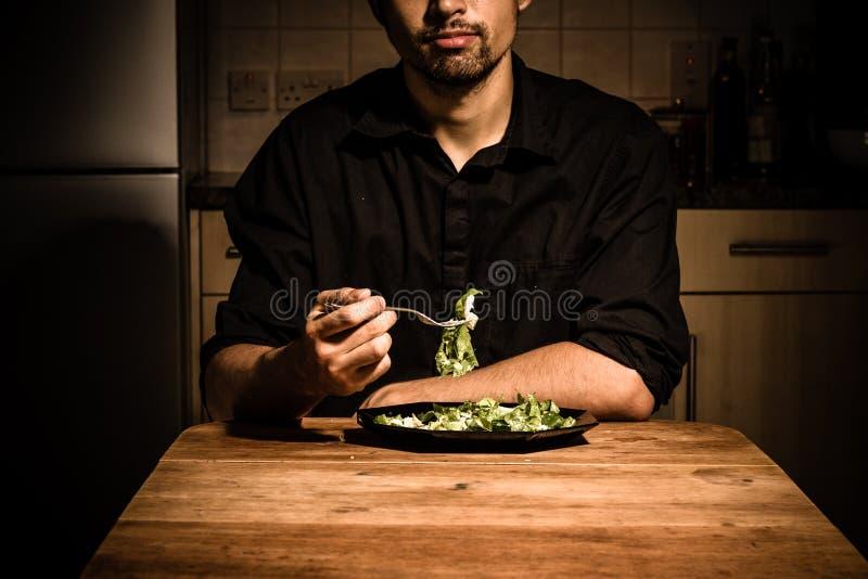 吃的人在家晚餐 免版税图库摄影