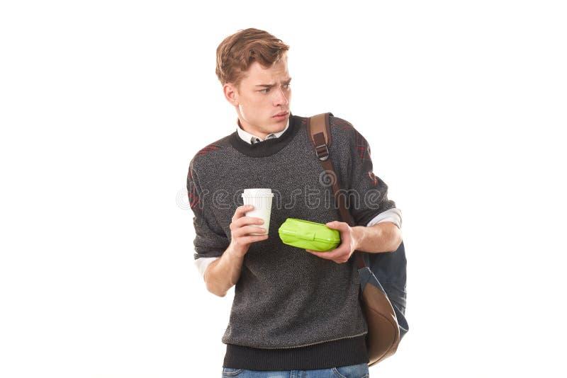 吃的男子大学生午餐 免版税图库摄影