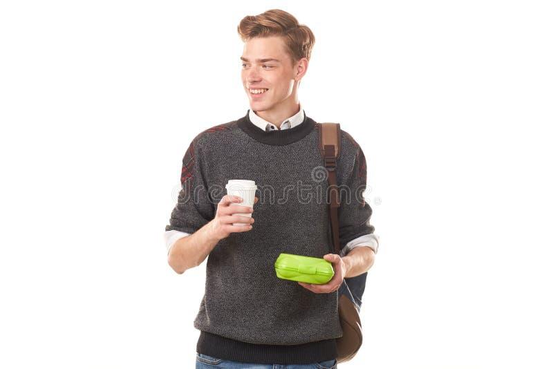 吃的男子大学生午餐 免版税库存照片
