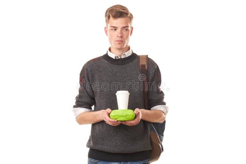 吃的男子大学生午餐 图库摄影