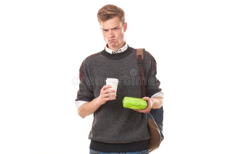 吃的男子大学生午餐 免版税库存图片
