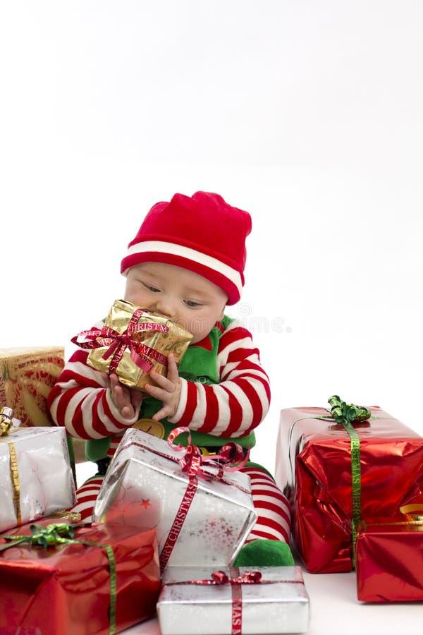 吃第一存在的babys圣诞节 图库摄影