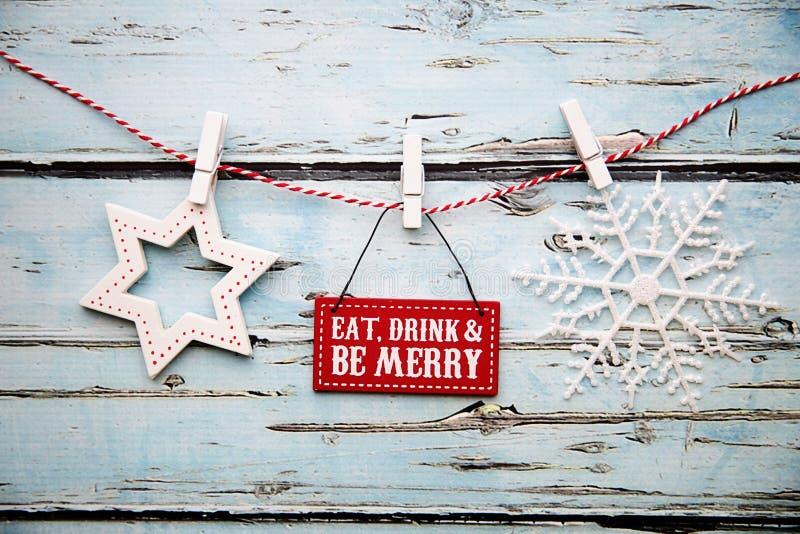 吃饮料并且是快活的标志 库存图片