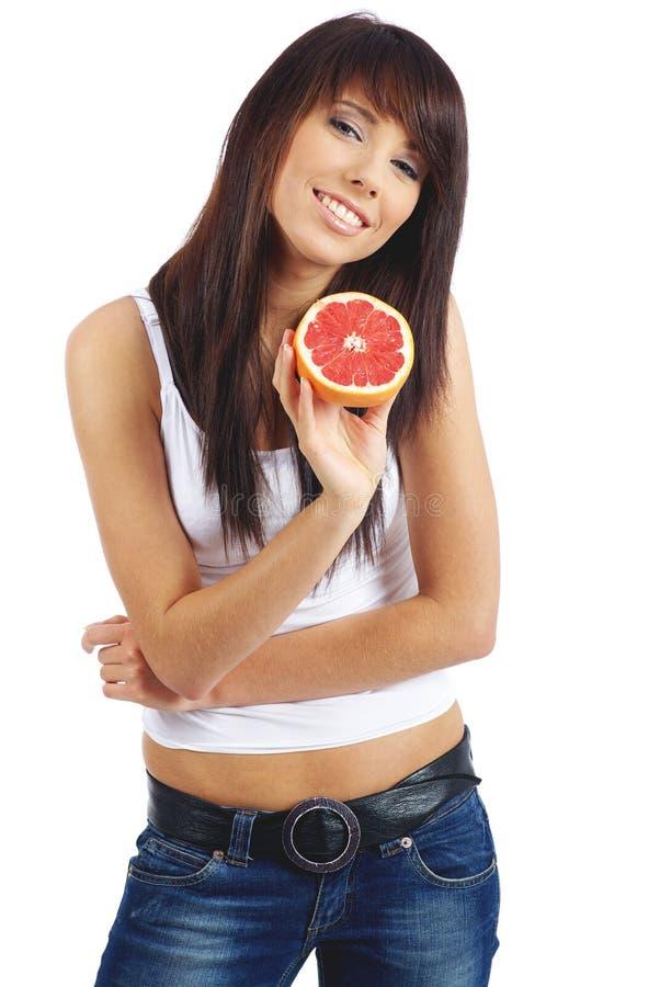 吃fruite妇女 库存照片