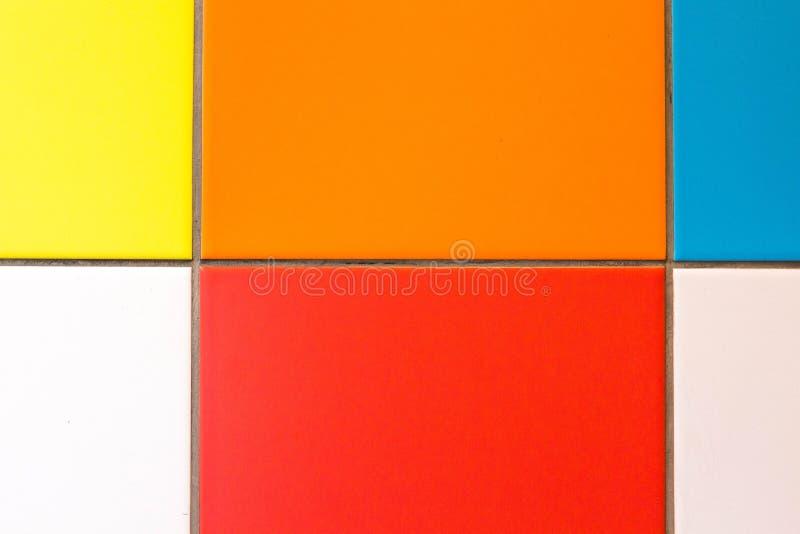 各种各样的明亮的颜色正方形  免版税库存照片