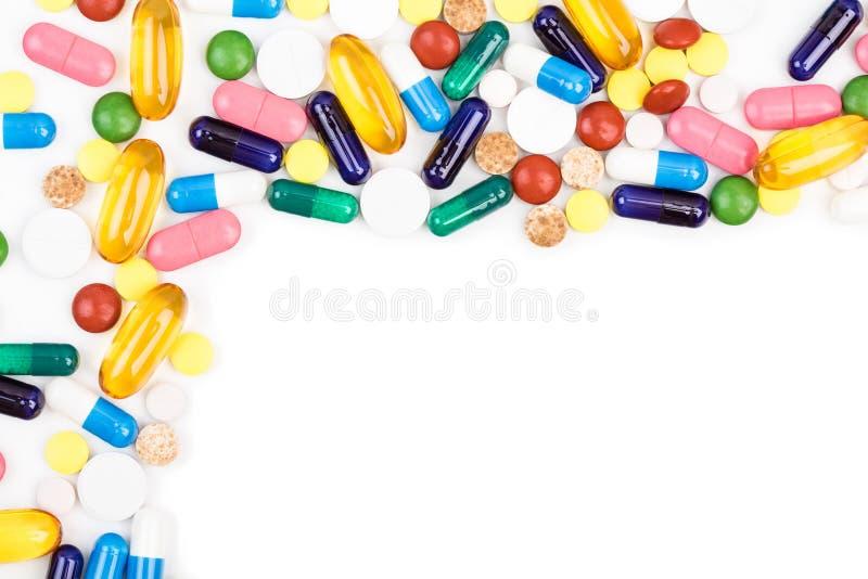 各种各样的颜色药片和胶囊 库存图片