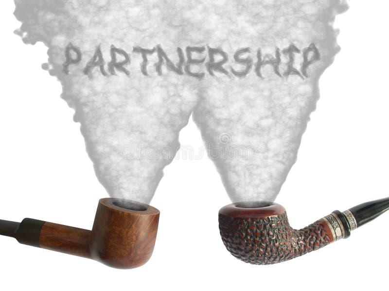 合伙企业用管道输送烟 免版税库存照片