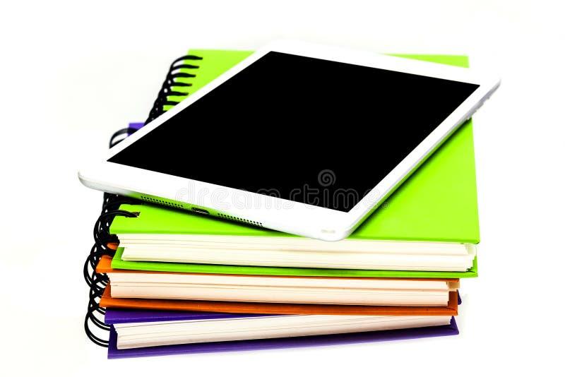 黏合剂书和片剂计算机isola 图库摄影