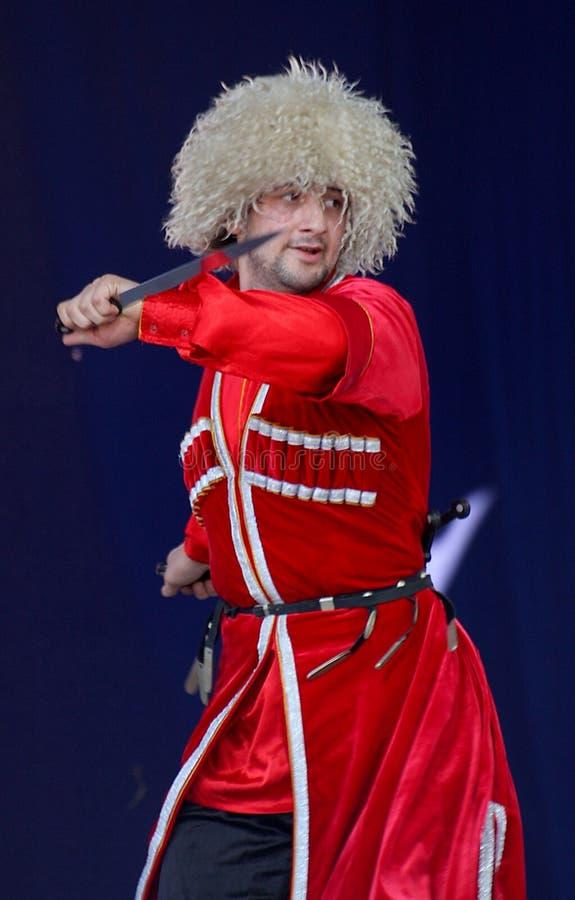 合奏imamat (太阳达吉斯坦)的独奏者舞蹈家表现  免版税库存照片