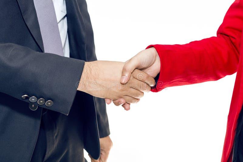 合并和承购 经理与妇女的商人握手 免版税库存照片