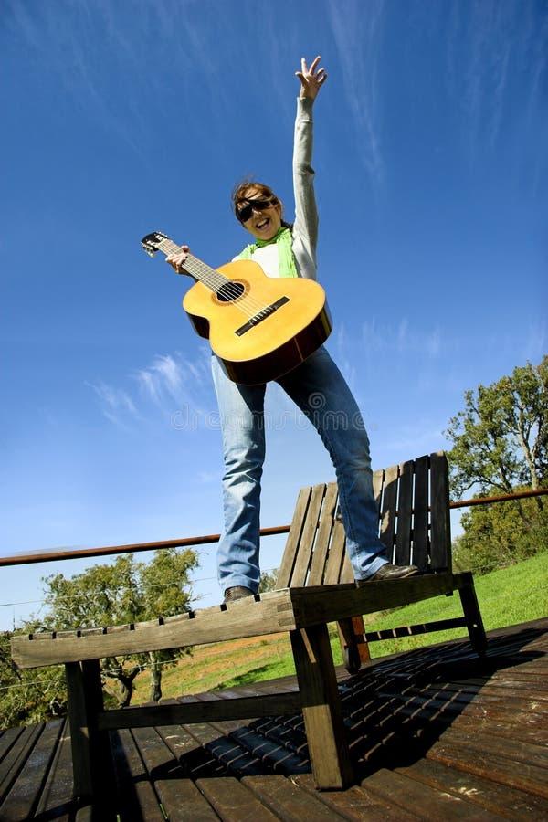 吉他妇女 图库摄影