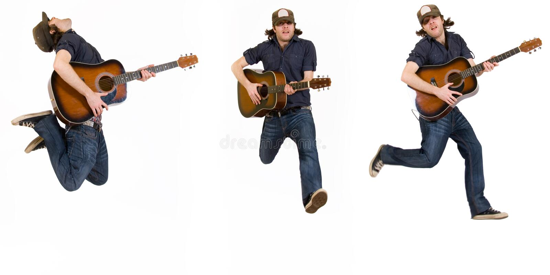 吉他弹奏者跳的姿势三 免版税库存图片