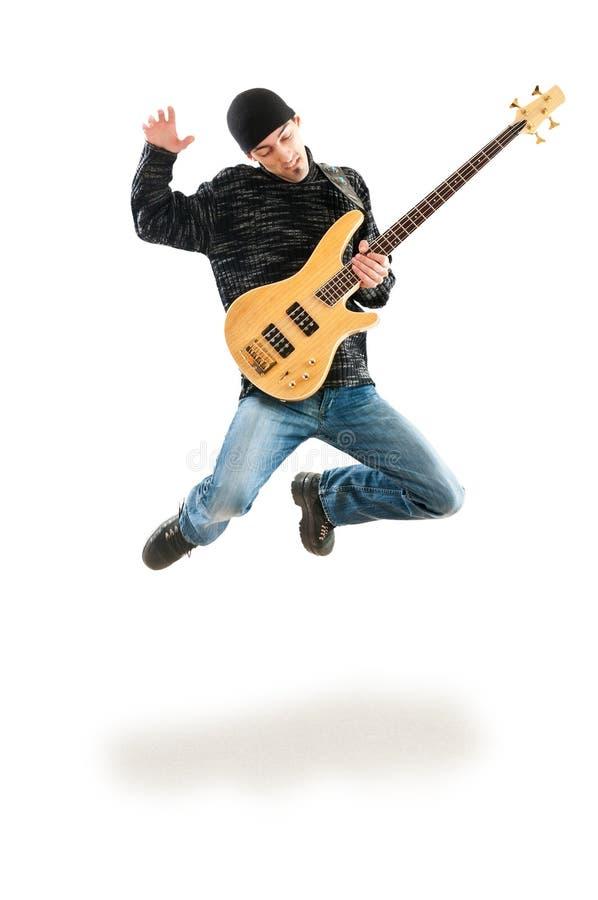 吉他跳的球员 免版税库存图片