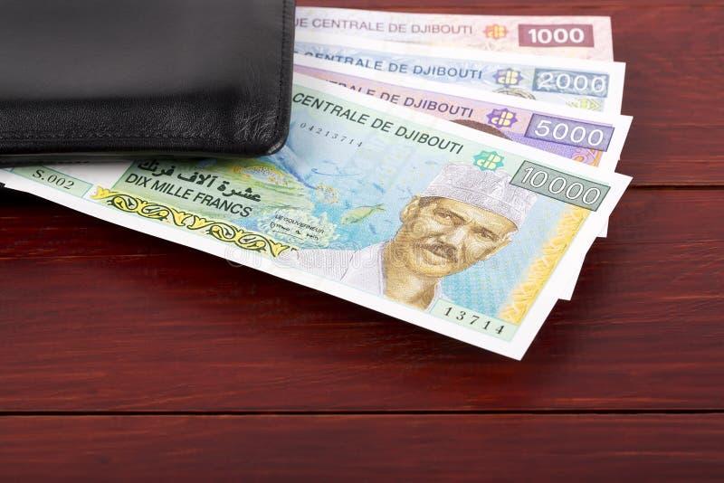 吉布提法郎在黑钱包里 库存照片