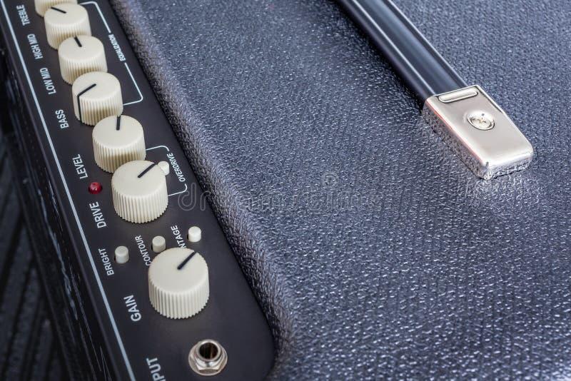 吉他功率放大器按钮  库存图片