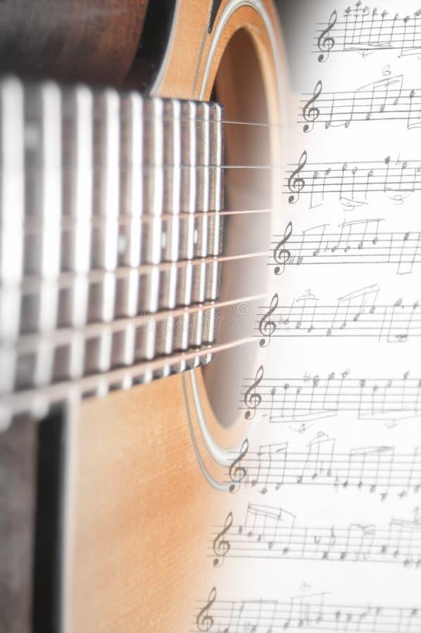 吉他和缩放比例 免版税库存照片