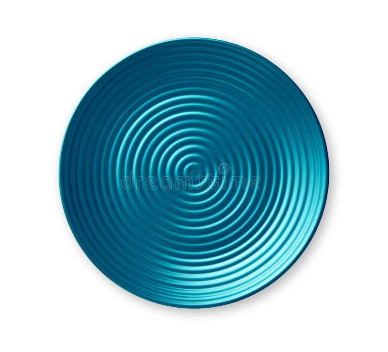 同心圆板材,在波浪样式,看法的空的蓝色陶瓷板材从上面隔绝在白色背景 免版税库存图片