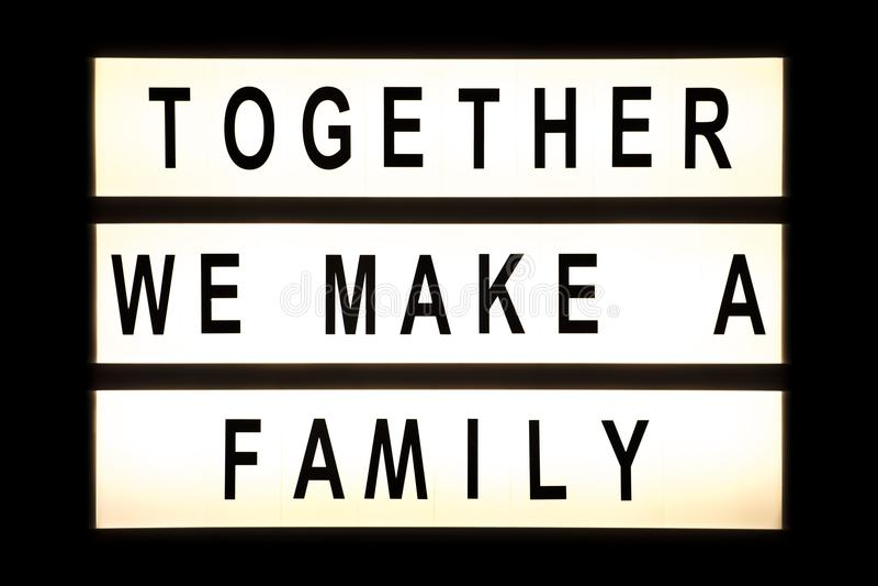同时我们做垂悬灯箱的一个家庭 库存照片