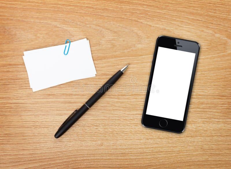 名片、笔和手机 免版税库存图片