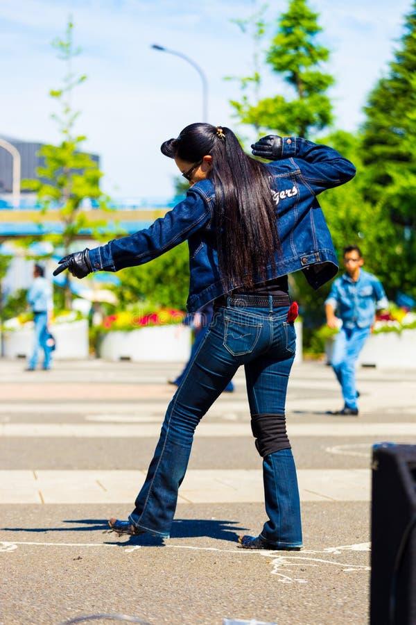 后方女性山区乡村摇滚乐充分的吉恩代代木公园东京 免版税库存图片