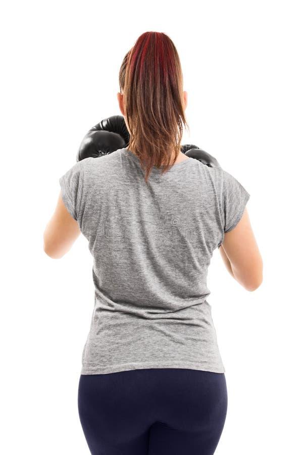 后面射击年轻女性拳击手 免版税图库摄影