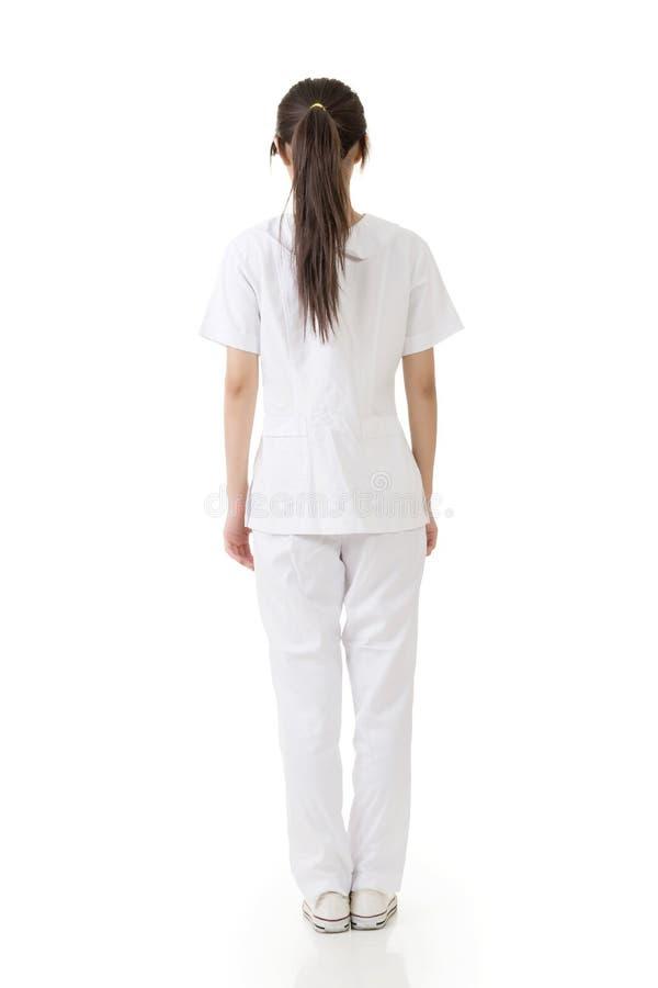 从后面的可爱的亚裔护士 免版税库存图片