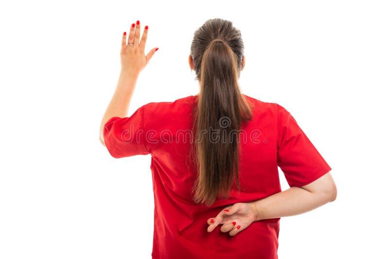 后面看法医疗护士佩带洗刷显示假誓言 库存照片