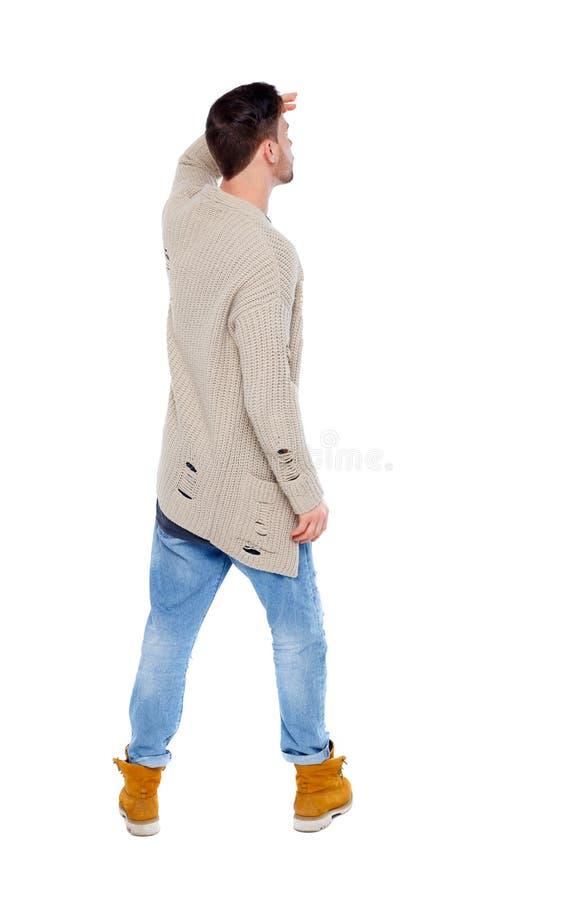 后面观点的一件被编织的毛线衣的一个人凝视入 库存照片