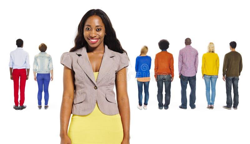 后面观点的不同种族的人民 图库摄影
